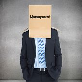 picture of anonymous  - Anonymous businessman against grey room - JPG