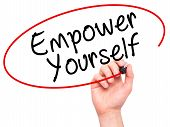 foto of empower  - Man Hand writing Empower Yourself with black marker on visual screen - JPG