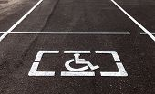 picture of physically handicapped  - Parking places with handicapped or disabled signs and marking lines on asphalt - JPG