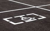 foto of physically handicapped  - Parking places with handicapped or disabled signs and marking lines on asphalt - JPG