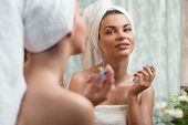 image of fragrance  - Young woman is trying her new fragrance - JPG