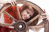 picture of wagon wheel  - young woman with an old wagon wheel on white background - JPG