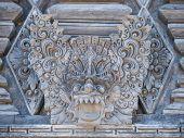 stock photo of immoral  - Stone sculpture on entrance door of Pura Padmasana Puja Mandala temple - JPG