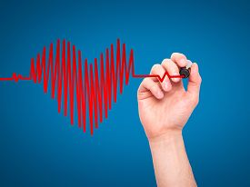 foto of beating-heart  - Closeup of hand drawing heart beat in heart shape - JPG