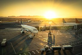 image of gate  - Airplane at the terminal gate ready for takeoff  - JPG