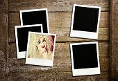 Retro photo frames on wood