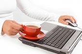 Hands of business woman with mouse and coffee