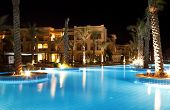 hotel and swimming pool at night