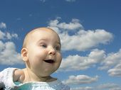 Happy Baby Under Clouds poster