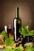 Red wine composition on dark background