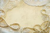 Vintage background with pearls and old doilies