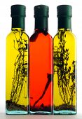 Three bottles of aromatic herbaceous and spicy oils