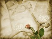 Romantic background with rose, pearls and vintage veils