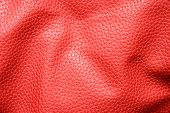 Rumpled red leather. Texture or background.