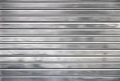 Abstract metal texture with horizontal horizontal lines.