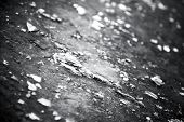 Broken glass on a ground closeup. Black and white concept.