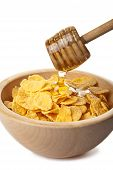 image of cereal bowl  - honey pouring over cornflakes isolated over white - JPG