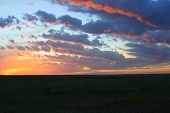 picture of western nebraska  - Sunset over prairie in western Nebraska with layered clouds - JPG