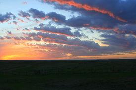 stock photo of western nebraska  - Sunset over prairie in western Nebraska with layered clouds - JPG