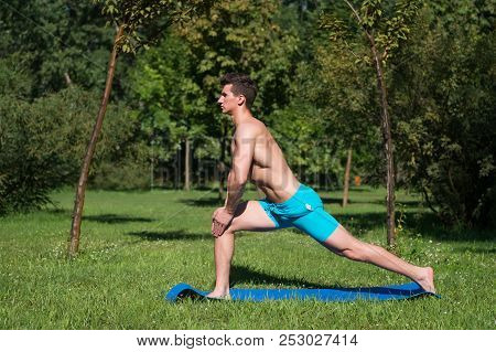poster of Fitness. Muscular Man Training On Fitness Mat Outdoor. Summer Activity Fitness. Fitness Man On Green