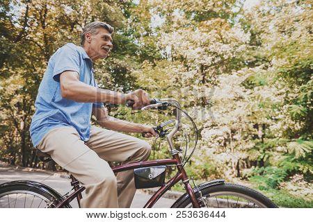 Old Man Sitting On Bicycle