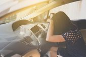 Asian Woman Sleepy Tired And Have A Headache While Driving Car poster