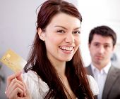 Woman holding a credit card happy with her financial solution