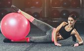 Slim, Bodybuilder Girl, Does The Exercises With Fitness Ball In The Gym. Sports Concept, Fat Burning poster