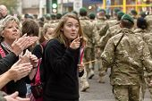 Woman points out to member of 3 Commando Brigade