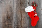 Christmas sock and wreath on wood