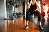 Fitness Woman Doing Squat Workout For Fat Burning And Legs Strength In Fitness Sports Gym With Sport poster