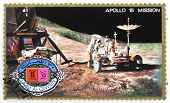UMM AL-QUWAIN - CIRCA 1975: A stamp printed in Umm al-Quwain shows astronaut David Scott on the moon