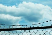 Chain link fence and sky background.