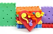 a pile of plasticine handicrafts, as a heart and cookies of many colors