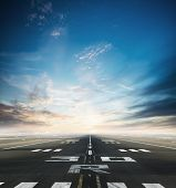 Empty asphalt airport runway with dramatic sky. poster