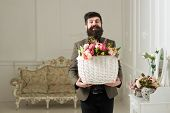 Fresh Concept. Bearded Man Hold Basket With Fresh Flowers. Man Smile With Fresh Floral Arrangement.  poster