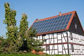 Old frame house with solar cells on the roof