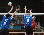 KAPOSVAR, HUNGARY - NOVEMBER 13: Balint Magyar (blue 6) in action at a Hungarian National Championship volleyball game Kaposvar (blue) vs. Nyiregyhaza (red), November 13, 2011 in Kaposvar, Hungary.