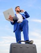 Man Well Groomed Businessman Holds Laptop Blue Sky Background. Guy Formal Suit Modern Technology Man poster