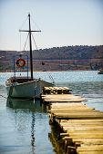 Jetty Pier On Tropical Sea Water Coastline With Boat Yacht. Maritime, Yachting Concept. poster