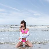 picture of monokini  - Young sexy brunette in swimsuit on the beach - JPG
