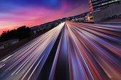 Traffic at twilight on 405 freeway in Los Angeles, California. Blurred Motion.