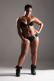 image of knickers  - BBW big beautiful african american woman showing off plus size curvy figure wearing sexy black lingerie and boots - JPG