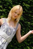 Cute Young Blond Lady In Garden