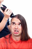 image of half-shaved hairstyle  - Unhappy long haired man being shaved with hair trimmer isolated on white background - JPG