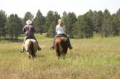 pic of horse riding  - Two People Riding on Ranch in Wyoming - JPG