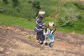Three women on their way to work in West Africa