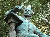 Monument To Composer Peter Tchaikovsky Before A Conservatory Building