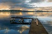 Sunrise in old wooden pier