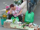 Poor Russian Rural Woman Sells Her Agricultural Products On August 02, 2012 In St. Petersburg, Russi